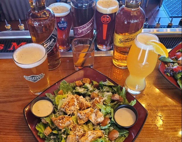 Raging Bull Steakhouse drinks and salad.